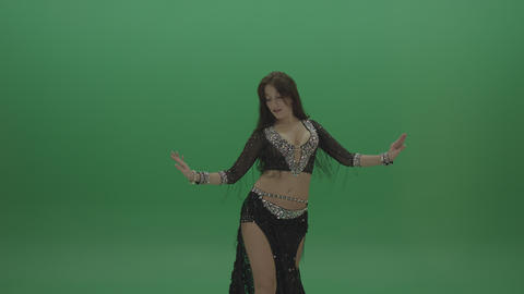 Beautiful belly dancer in black wear display unique dance moves over chromakey Live Action