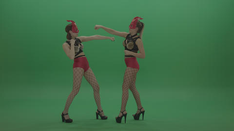 Appealing PJ Demons Go Go Dancers in Red Mask on Green Screen Stock Footage