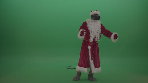 Santa in VR moves around over chromakey background Live Action