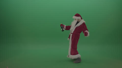 Drunk santa with bottle of wine staggers across the green screen background Footage