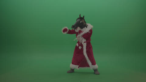Horse head santa displays his boxing skills over chromakey background Footage