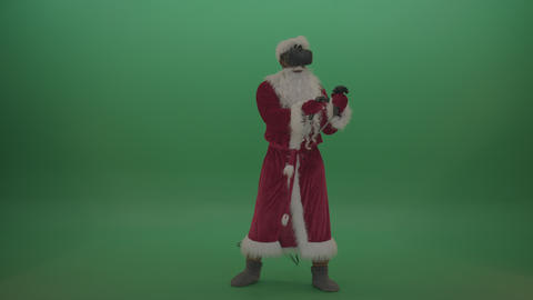 Santa with VR gears shoots imaginary gun around over chromakey background Live Action