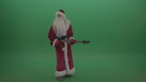 Santa the rockstar shows his amazing skills over green screen background Live Action