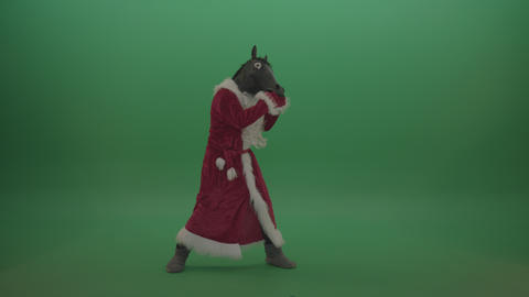 Horse head santa displays his fight techniques over green screen background Footage