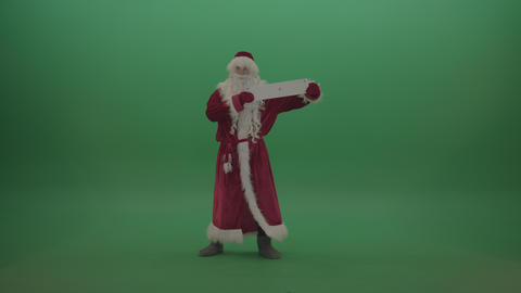 Santa displays plus sign postcard over chromakey background Live Action