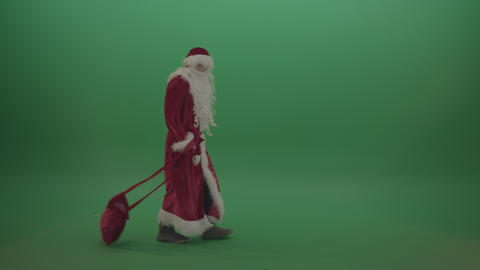 Santa walks around with gift bag over chromakey background ライブ動画