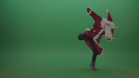 Amazing santa displays his flying kick skills over green screen background Live Action