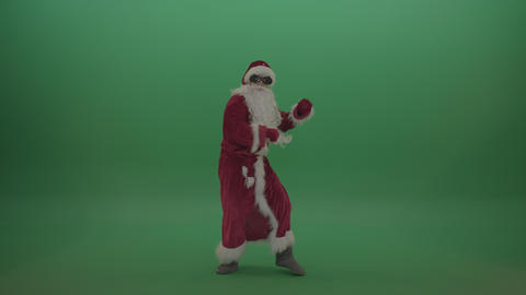 Santa in glasses shows his dance skills over chromakey background Footage