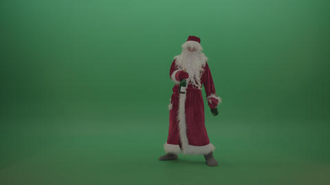 Drunk santa staggering across the chromakey background with two bottles of wine ライブ動画