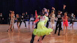 Slow motion of anonymous defocused people dancing latin dances. Ballroom dancing Live Action