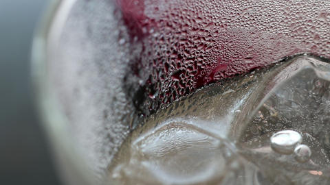 Abstract beauty in drink details. Extreme close-up of iced plum juice soda Live Action