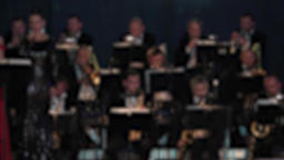 Brass orchestra is playing music. Defocused Live Action