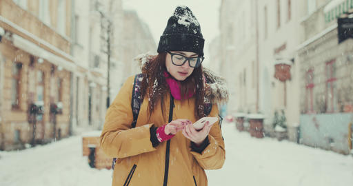 Girl in her 20s using smartphone for directions. Lost tourist using app on Live Action