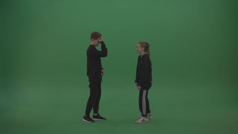 Boy in black wear talks to girl over chromakey background ライブ動画