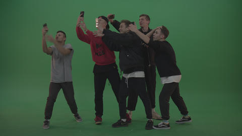 Break dance team take group selfies over green screen background ライブ動画