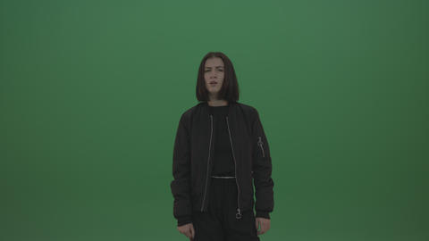 Girl in black wear poses over chromakey background Live Action