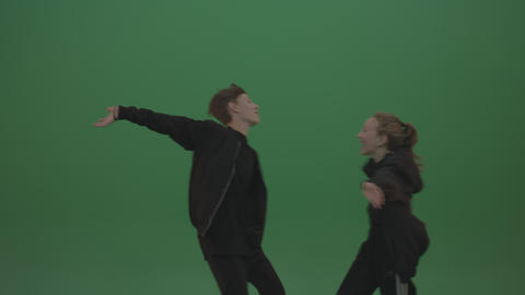 Two kids smile and hug each other over chromakey background Footage