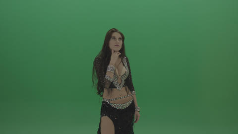 Beautiful belly dancer in black wear operates invisible screen as she poses over ライブ動画