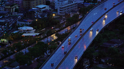 Roads and highways in Bangkok City at dusk in transportation concept, Thailand Live Action