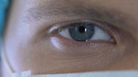 Doctor eye closeup, health care occupation, concentrated surgeon responsible job Footage