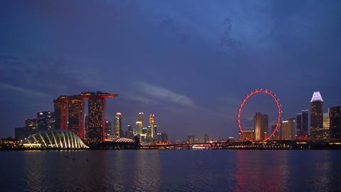 Downtown Singapore city in Marina Bay area with reflection. Financial district Live Action