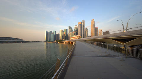 Downtown Singapore city in Marina Bay area at sunrise. Financial district and Live Action