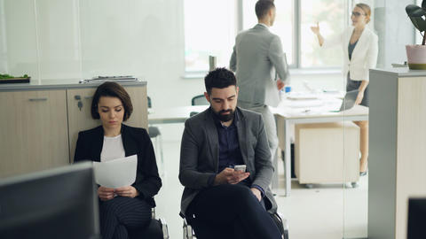 Young people man and woman are waiting for job interview in office while manager Footage