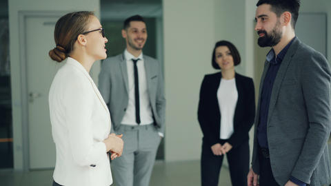Cheerful manager is congratulating successful candidate after job interview Footage