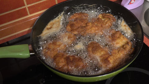Schnitzel fried in the olive oil in a frying pan ライブ動画