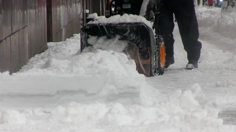 Man uses snow blower to clear snow from driveway Footage