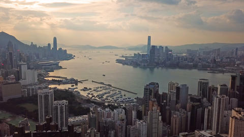 Hong Kong Downtown and Victoria Harbour. Financial district in smart city. Live Action