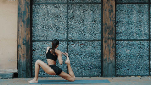 Young beautiful woman practicing yoga. Wellness concept. Calmness and relax Live Action