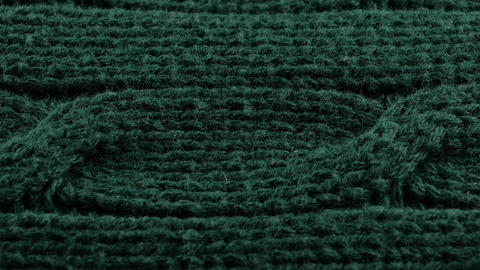 Pigtails on Green Knitwear Fabric Texture. Machine Knitting Texture Macro Live Action