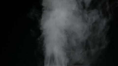 White water vapour on a black background. Close-up shot Live Action