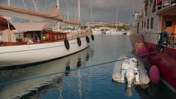 Classic sailing and motor superyachts moored in marina, 4k Footage