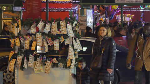 Street vendor selling Greek lottery payslips in Thessaloniki, Greece Footage