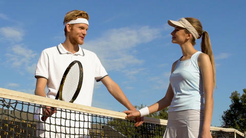 Couple enjoying sport weekend at hotel complex, tennis lessons, relationship Footage