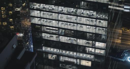 4K Exterior establishing shot of a modern office building at night Live Action
