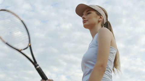 Attractive young woman on tennis court, healthy lifestyle, winner spirit Live Action