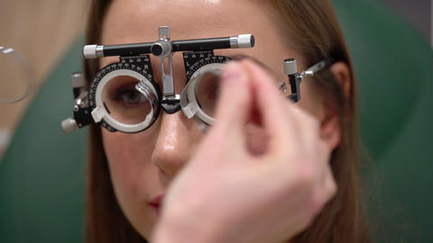 Woman at the reception of an ophthalmologist. Eye examination and selection of Footage