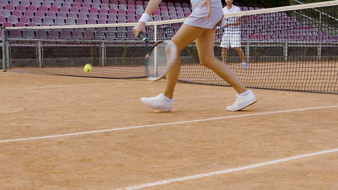 Female tennis player practicing to return ball, good reaction, sport lessons Footage