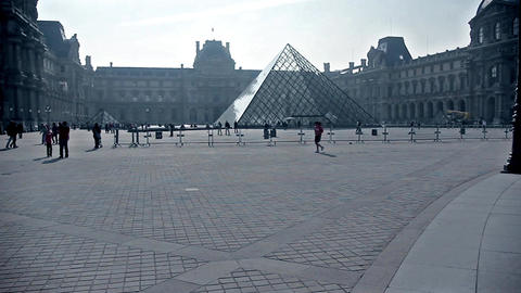 Pyramid at the Louvre Museum in Paris, France Live Action
