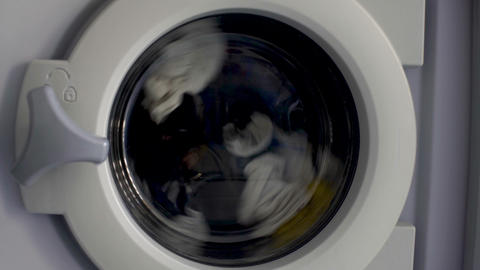 Washing machine cleaning clothes, laundry day at home, household appliance Footage