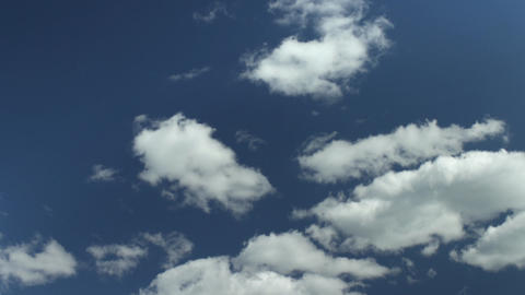 Fluffy white clouds moving fast Footage