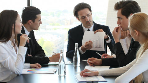 Business People Discussing Charts stock footage