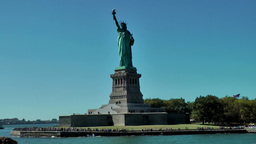 USA New York City 398 passing statue of liberty in front dreamlike blue sky Footage