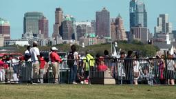 USA New York City 403 Brooklyn Skyline behind Liberty Island shore promenade Footage
