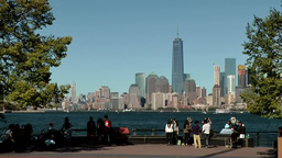 USA New York City 417 Liberty Island riverside promenade with Manhattan skyline Footage