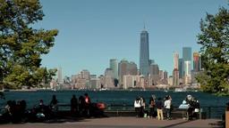 USA New York City 417 Liberty Island riverside promenade with Manhattan skyline Footage