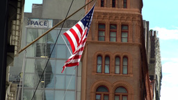 New York City 459 Lower Manhattan downtown stars and stripes flag in a street Footage